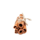 Bundle of cinnamon sticks on white background. Royalty Free Stock Images