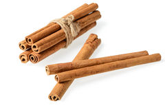 Bundle of cinnamon sticks on white Royalty Free Stock Image
