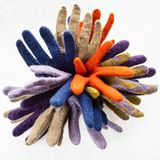 Bundle from colour felted gloves on gray royalty free stock images