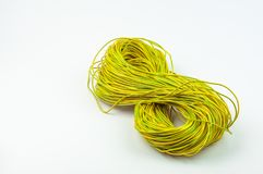 Abundle of copper wire yellow green on a white background stock photo