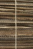 Bundle of corrugated cardboard tied with string close-up full frame Stock Image