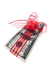A bundle of dollar bills. Hundert dollar bills with a red ribbon. symbol for money gift Stock Photos