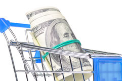 Bundle of dollars in shopping cart Royalty Free Stock Images