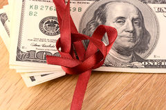 Bundle of dollars tied with ribbon Stock Photo