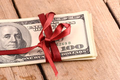 Bundle of dollars tied with ribbon Stock Images
