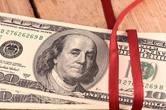 Bundle of dollars tied with ribbon Stock Image