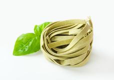 Dried ribbon pasta. Bundle of dried ribbon pasta stock images