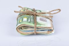 A bundle of euro bills tied with a rope and placed on white. Background Stock Photography