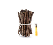 Bundle of firewood with lighters on white Royalty Free Stock Photography