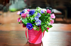 Bundle of flowers on the table. Bundle of flowers in the pink vase on the table Stock Image