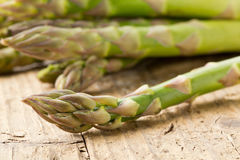 Bundle of fresh cut raw, uncooked green asparagus vegetable Stock Photo