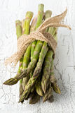 Bundle of fresh cut raw, uncooked green asparagus vegetable Royalty Free Stock Photo