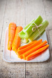 Bundle of fresh green celery stems and carrot Stock Image