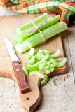 Bundle of fresh green celery stems and knife Stock Photos