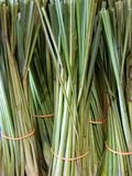 A bundle of fresh lemongrass. Fresh lemongrass for sale at Labuan Fresh Market, Malaysia. Lemongrass is widely used as a culinary herb in Asian cuisines and also Stock Photo
