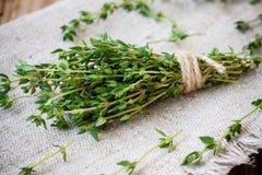 Bundle of fresh thyme on sackcloth Royalty Free Stock Photo