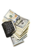 A bundle of hundred-dollar bills and a purse. A bundle of hundred dollar bills and a purse on a white isolated background Royalty Free Stock Photography