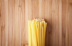 Bundle of Italian spaghetti pasta tied with string lying on old Stock Images