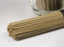 Bundle of japanese soba noodles. Made of buckwheat flour on a light background, uncooked Stock Images