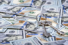 Bundle of keys on dollar bills background Stock Photography