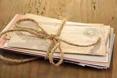Bundle of letters. Tied with a cord on the old wooden table Stock Image