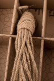 Bundle of linen rope  in brown background Royalty Free Stock Images