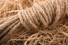 Bundle of linen rope  in straw background Stock Photo