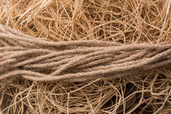 Bundle of linen rope  in straw background Royalty Free Stock Image