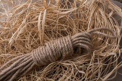Bundle of linen rope  in straw background Stock Photos