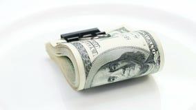 Bundle of many 100 dollar bank notes rotating stock footage