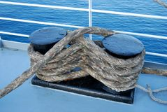 Bundle of marine ropes on the mooring bollard stock photography