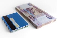 Bundle of money and bundle of card Royalty Free Stock Image