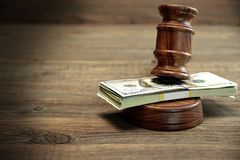 Bundle Of Money, Judges Gavel And Soundboard On Wooden Table Stock Images