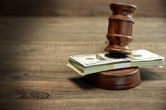 Bundle Of Money, Judges Gavel And Soundboard On Wooden Table. Concept For Corruption, Bankruptcy Court, Bail, Crime, Bribing, Fraud, Auction Bidding. Judges or Stock Images