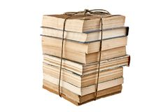 Bundle of old books tied up with string. Isolated on white background stock images