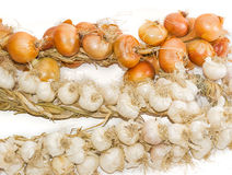 Bundle of onions and on garlic a light background closeup Royalty Free Stock Photo