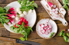 Bundle of organic radishes on a table. Royalty Free Stock Photo
