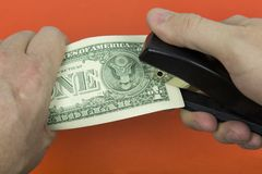 Paper money dollars and a stapler. royalty free stock photo