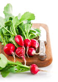 Bundle radish on wooden board with knife Stock Photography