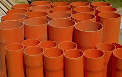 A bundle of red pvc pipes Stock Photos