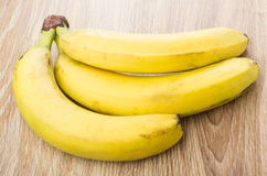 Bundle of ripe yellow bananas on table Royalty Free Stock Image