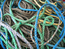 Bundle of ropes. Lots of different coloured fishing ropes royalty free stock photos