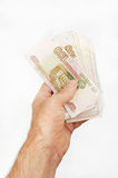 Bundle of Russian rubles in male arm Stock Photo