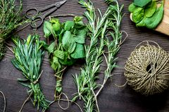 Sage and thyme, mint, estragon on wooden background top view stock photos