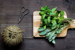 Bundle of sage and thyme on wooden board top view Royalty Free Stock Images