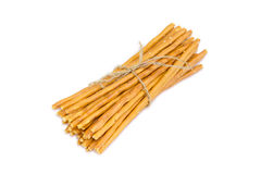 Bundle of salty pretzel rods on a light background Royalty Free Stock Photos
