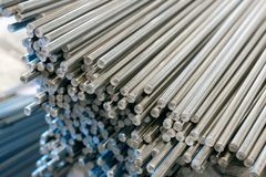 A bundle of stainless steel bars. Large industrial warehouse metal royalty free stock photography