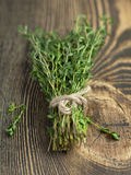 Bundle of thyme on a brown wooden background Stock Photo