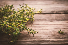 Bundle of thyme on the old wooden board Royalty Free Stock Images