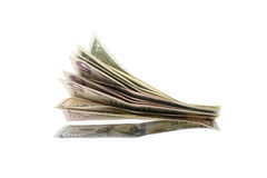 Bundle of US bills. Spread bundle of US bills, isolated on white Royalty Free Stock Photos